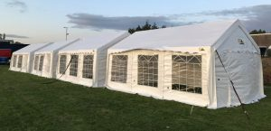 Three marquees in a field